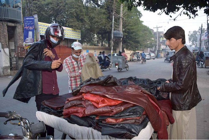 A vendor displaying leather jackets to attract the customers