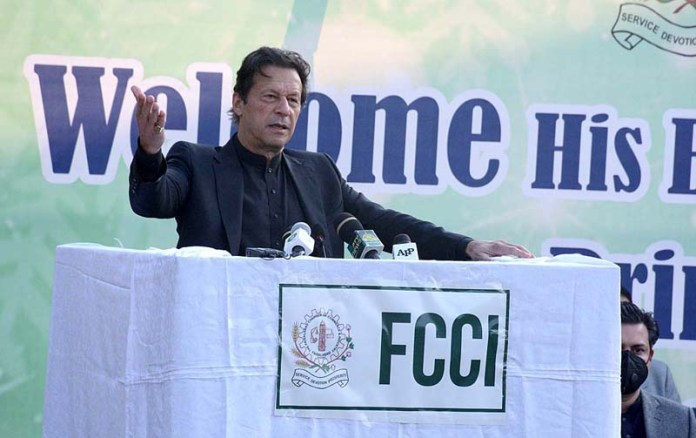 Prime Minister Imran Khan addressing during a function of Faisalabad Chamber of Commerce and Industry (FCCI)