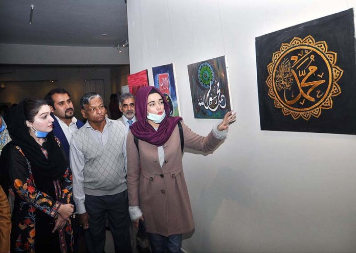 Chairperson Peace and Culture Organisation Mushaal Hussein Mullick viewing the displayed stuff during calligraphy exhibition at Arts Council