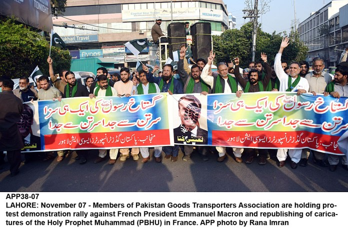 LAHORE: November 07 - Members of Pakistan Goods Transporters Association are holding protest demonstration rally against French President Emmanuel Macron and republishing of caricatures of the Holy Prophet Muhammad (PBHU) in France. APP photo by Rana Imran