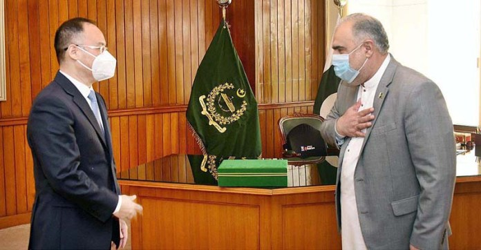 ISLAMABAD: November 11 - Speaker National Assembly Asad Qaiser receiving Ambassador of China Nong Rong at Parliament House. APP
