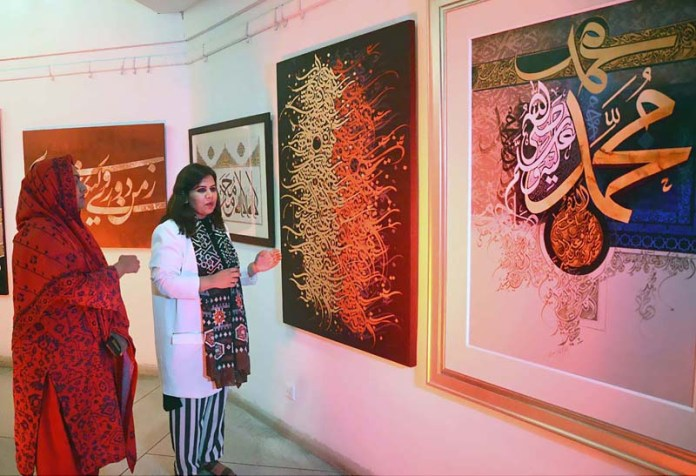 Executive Director Al-Hamra Arts Council Summan Ray viewing calligraphy work during Shan-e-Risalat (SAWW) ceremony at Arts Council