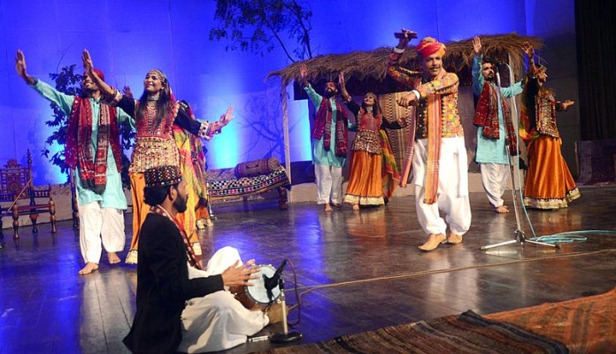 Artists performing on stage during Sindh Culture Day at Al-Hamra Arts Council