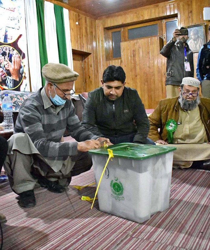 Returning officer open the seal of polling box for counting votes after polling time during Gilgit-Baltistan Election 2020 at Fatimah Jinnah Women College