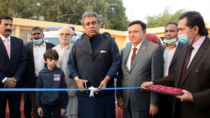 Federal Minister Maritime Affairs Syed Ali Haider Zaidi cutting the ribbon to inaugurate ambulance service at Port Qasim
