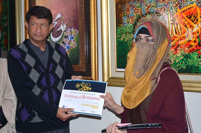 Vice Chancellor Dr. Ishtiaque Ahmad distributing certificates among the participants during calligraphy exhibition in connection with the Shane-e-Rehmatul-Lil-Alameen (SAWW) week celebrations at Sargodha Universty