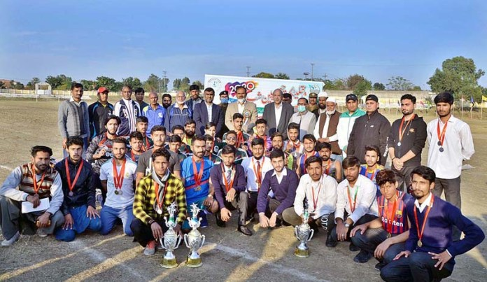 Deputy Commissioner Ali Annan Qamar in a group photo with position holder students during Inter-College/School Athletic Meet 2020 organized by Sports Department at Quaid-e-Azam Stadium