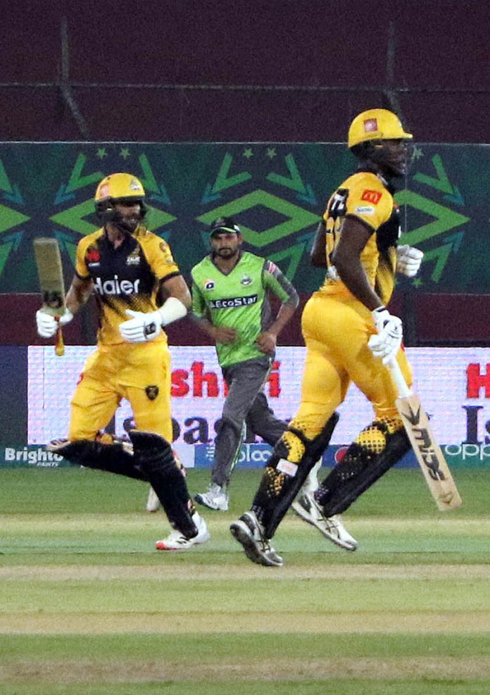 A view of cricket match between Peshawar Zalmi and Lahore Qalandars during Pakistan Super League (PSL) Twenty20 match played at the National Stadium