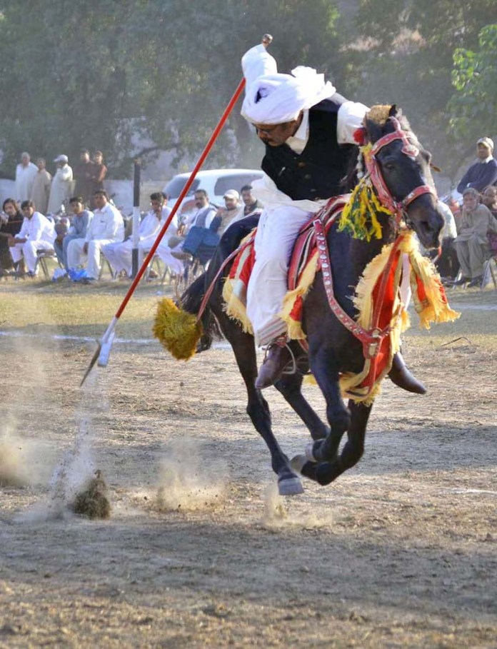 ATTOCK: November 01 - Players participating in tent pegging competition at Quaid-e-Azam Stadium. APP photo by Ghulam Shabbir