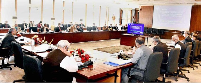 ISLAMABAD: November 04 - Adviser to the Prime Minister on Finance Dr. Abdul Hafeez Shaikh chairing a meeting of the Economic Coordination Committee of the Cabinet. APP