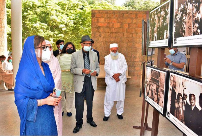 KARACHI: November 09 - Renowned Artist Aslam Kamal viewing pictures after inaugurating the Photographic Exhibition of Alama Iqbal on Iqbal Day Celebration organized by Farogh-e-Iqbaliyat Forum in collaboration with Office of Research, Innovation & Commercialization (ORIC) University of Karachi and Directorate of Electronic Media and Publications Government of Pakistan (DEMP) at University of Karachi in Provincial Capital. APP Photo by M Saeed Qureshi