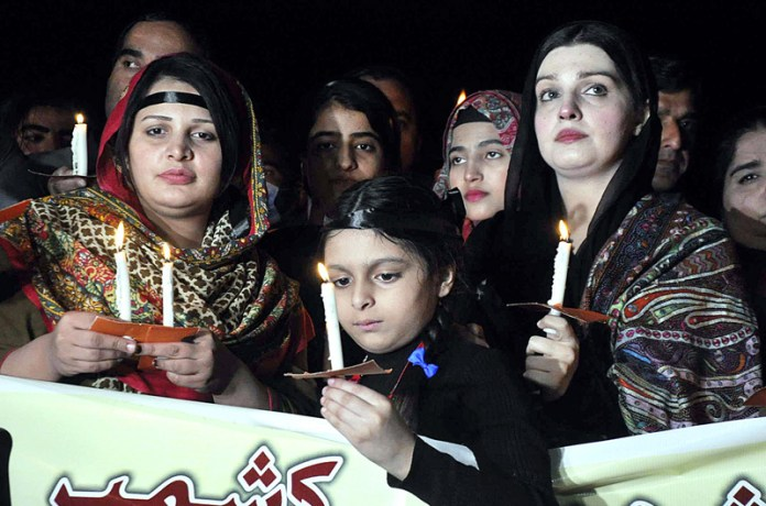ISLAMABAD: November 06 - Chairperson Peace and Culture Organisation Mushaal Hussain Malik along with civil society members participating in a Candle Light Vigil in Remembrance of the Martyrs of Jammu Massacre in 1947 and to express solidarity with victims of Indian oppression in Occupied Jammu and Kashmir at Outside National Press Club. APP photo by Saleem Rana