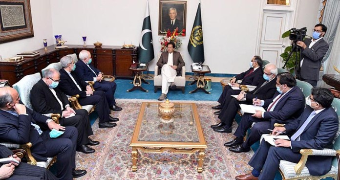 ISLAMABAD: November 11 - Foreign Minister of Iran Dr. Javad Zarif called on Prime Minister Imran Khan. APP