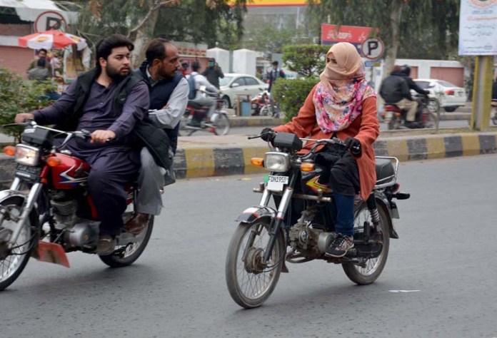 A girl riding motorcycle heading towards her destination