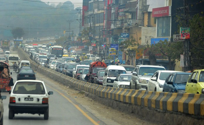 A view of massive traffic jams on Murree Road near Bharakoh