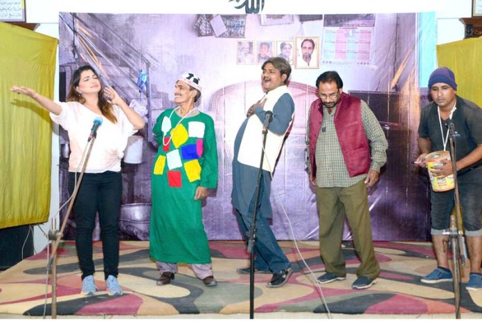 Stage artists performing on the stage during a drama titled 'Bolo Kya Baat Hai' at press club hall