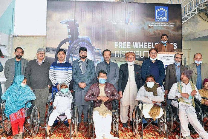 MD Bait ul Mal Aon Abbas Buppi in a group photograph during wheelchair distribution ceremony organized by Alkhidmat Foundation