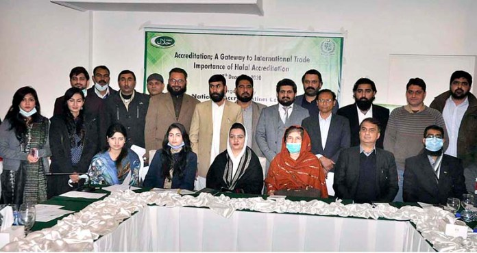 Director General Pakistan National Accreditation Council MoS & T Ms. Ismat Gul Khattak in a group photograph with participants at Media Awareness Seminar on
