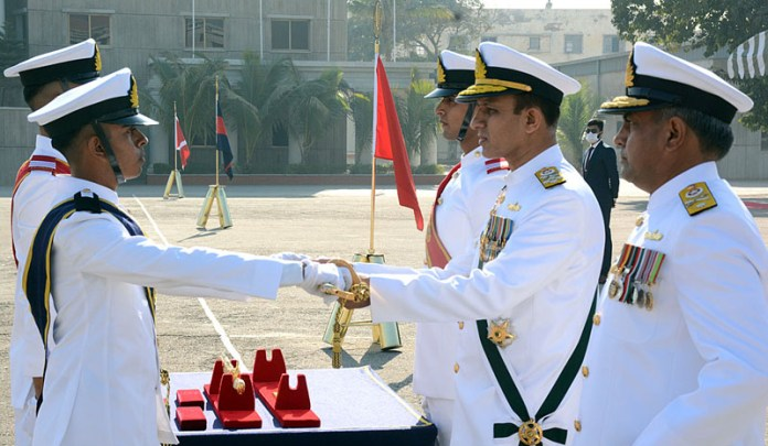 Chief of the Naval Staff Admiral Muhammad Amjad Khan Niazi awarding Sword of Honour to the best all round midshipman during 114th Midshipmen Commissioning Parade at Pakistan Naval Academy Manora