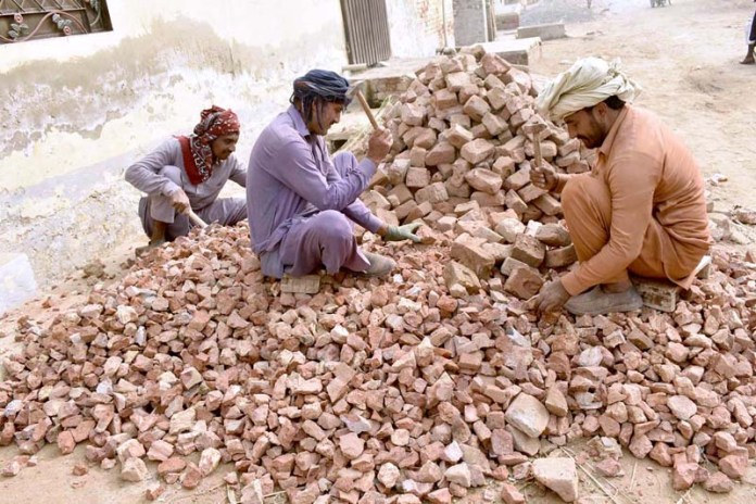 Laborers busy in crushing bricks to earn livelihood