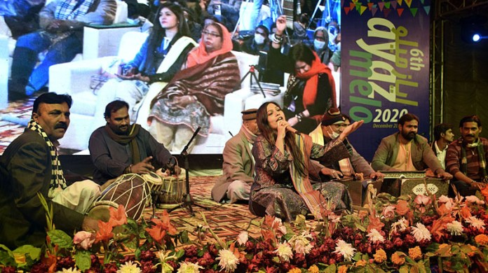 Folk artists performing on the stage during 6th Ayaz Mela organized by Khanabadosh Writers Café at Sindh Museum