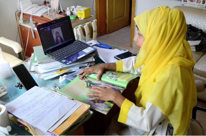 A teacher conducting online classes for students on laptop as schools are closed due to 2nd phase of corona virus pandemic