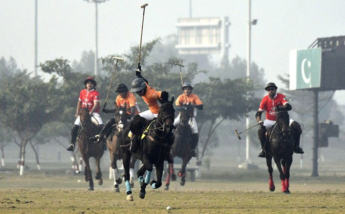 Polo plyers struggling to get hold on the ball during a match between LPC Remington Pharma polo and LGPC Servise Tyres polo teams during Pakistan Under-19 Junior Polo Cup at Jinnah Polo and Country Club. LPC Remington Pharma won by 6-3