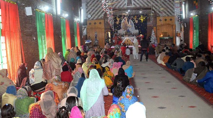 People from Christian community busy in their religious rituals at Catholic Church to mark the Christmas celebrations