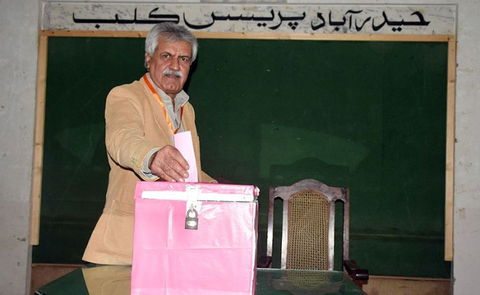A journalist casting his vote during Press Club election