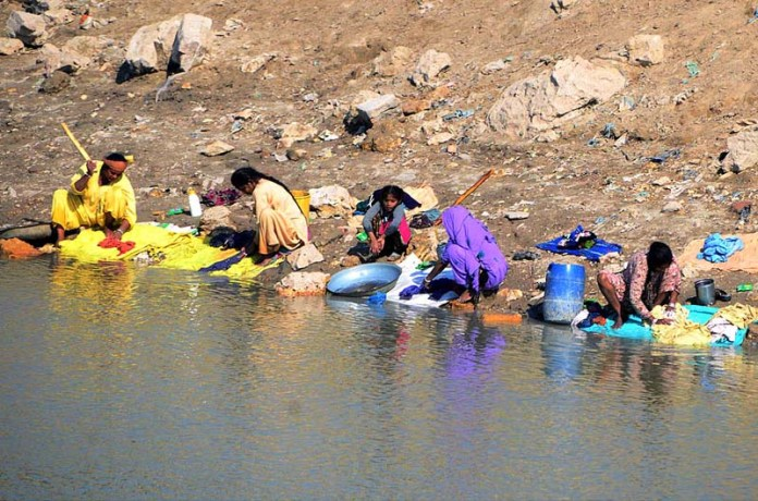 Women busy in washing the clothes at Phuleli Canal