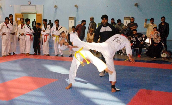 A view of taekwondo match between Bahawalnagar and Rahimyar Khan teams during Commissioner Cup Sports Gala 2020