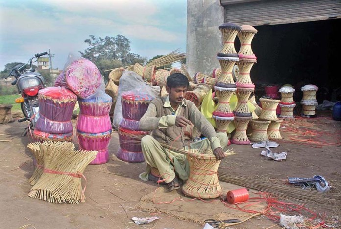Worker busy in preparing traditional stool at his workplace