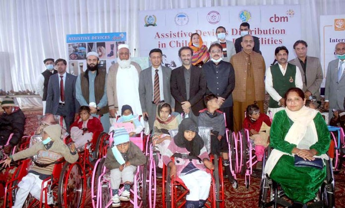 MD Pakistan Bait ul Maal Aon Abbas Bappi in a group photo with disabled children during assistive device distributing in children with disability ceremony at Railway Club