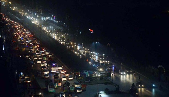 A view of massive traffic jam during night time at Hashtnagri Road