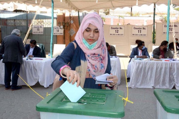 Voter casting her vote during Arts Council Election 2021-2022 at Arts Council