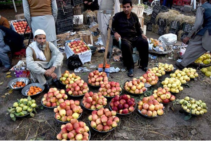 Vendors displaying seasonal fruits to attract the customers at Fruit and Vegetable market in the Provincial Capital