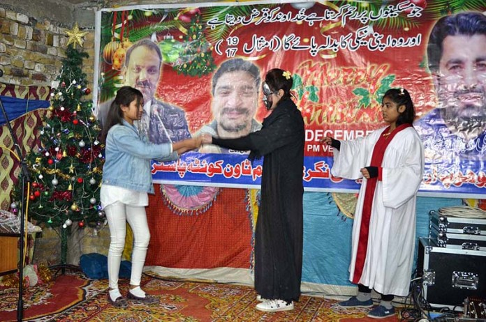 Children performing in tableau during function in connection with Christmas celebrations at Eisa Nagri