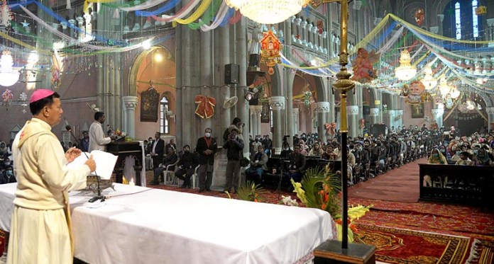 People from Christian community busy in their religious rituals in Sacred Heart Cathedral to mark Christmas celebrations