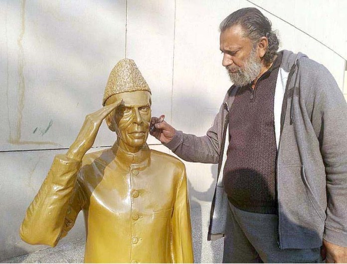 An artist giving final touch of a statue of founder of Pakistan Quaid-e-Azam Muhammad Ali Jinnah