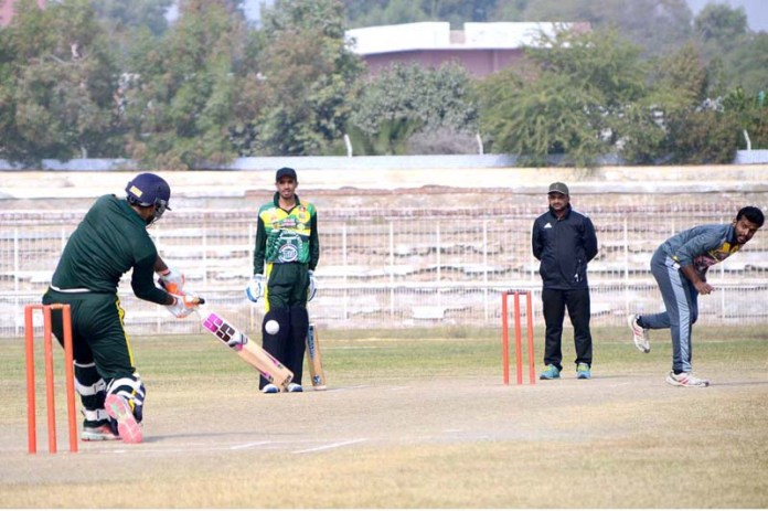 Players in action during cricket match between the Palm Cricket Club & Awais Cricket Club during all Pakistan S & S T-20 League Cricket Championship 2021 at Niaz Cricket Stadium