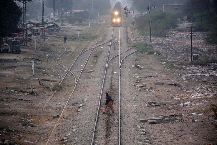 A person crossing railway tracks as train approaching on the same track may cause any mishap and needs the attention of concerned authorities