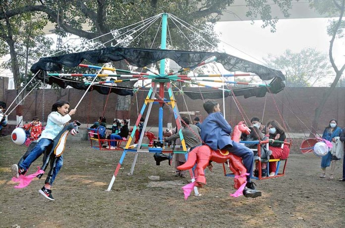 Children enjoying on swings at Naulakha Church