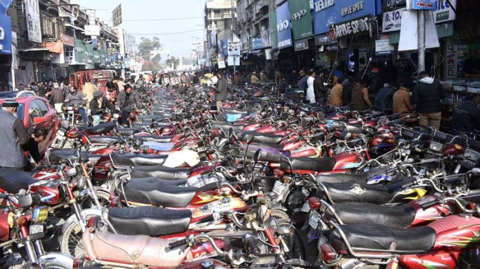 A large number of motorcycles parked at Katchery Bazaar depicts that there is great hustle and bustle in business activities in downtown area of Faisalabad despite second wave of coronavirus pandemic