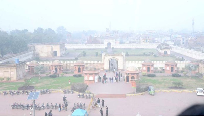 A beautiful view of Shalamar Bagh where people are flocking to the main gate for a walk during fog that engulfs the city