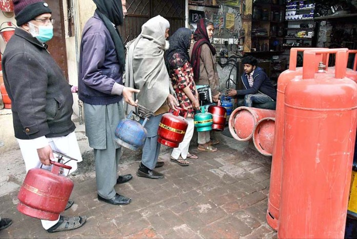 People waiting for their turn for filling LPG gas cylinders due to low pressure of gas in the different areas of the Provincial Capital