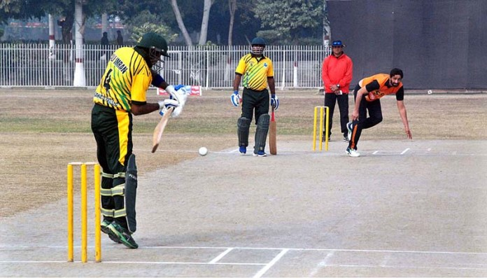 Players in action during final cricket match of 1st Deputy Commissioner T-20 C Cricket Tournament 2020 played between Khawaja Farid and Sir Sadiq teams