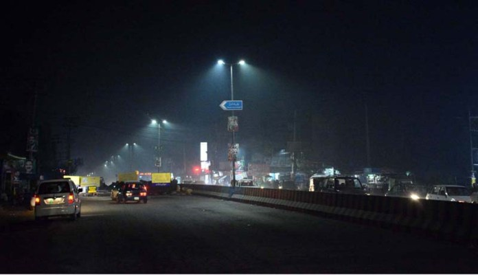 A view of thick fog that engulfs the whole city during night time