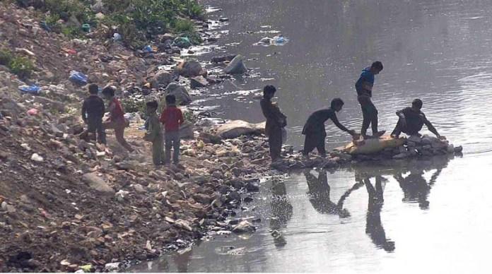 Children playing on the banks of Nallah Lai at Peerwadhai area
