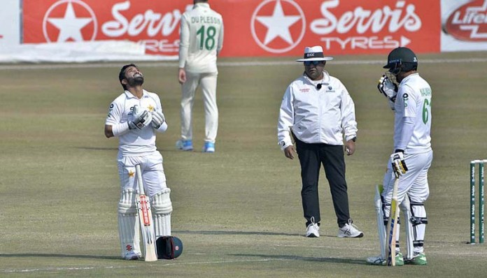 Pakistani batsman Mohammad Rizwan offering dua after scoring a century (100 runs) during the fourth day of the second Test cricket match between Pakistan and South Africa at the Rawalpindi Cricket Stadium