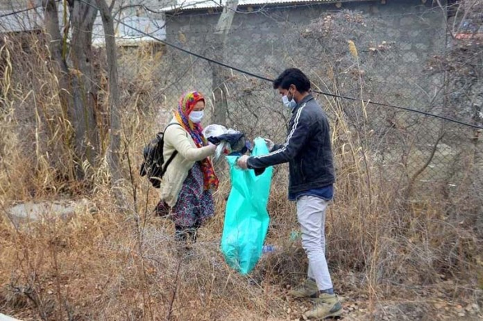 Volunteers of Kaar-e-Khair organization busy in collecting garbage during Clean & Green Campaign at Forest Recreational Park organized by Forest Department Skardu